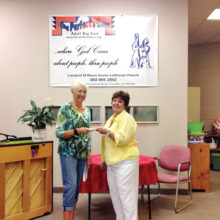 """Kay Thayer presents check to Judy Waltersdorf. Kay Thayer says """"Thanks for all you do in helping to meet those special needs for those special people in our community."""""""