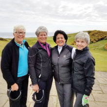 Pictured are (l-r) B. J. Schuler, Judi Sloan, and Elaine Osborn in Scotland with one of the LPGA's all-time greatest stars, Nancy Lopez. The weather was cool (jackets) but the smiles look warm, don't they?