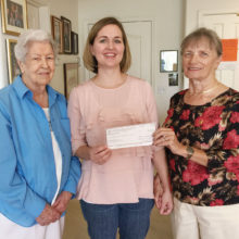 PCE grant recipient Raena Woods is presented a check by Lucy Everingham and Becky Paschal-Snyder of Chapter DD.