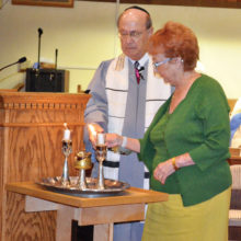 Candle lighting by Rabbi Wiener and Sandi Wiener