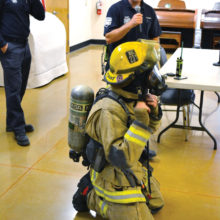 SLFD Captain Cory Evans explains what a firefighter wears inside a fire and how different they would look and sound in a time of an emergency.