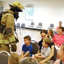 SLFD firefighter Dave DeGraaf shows children up close how different a firefighter looks and sounds inside of a fire.