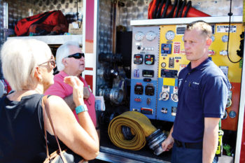 Though the event was held for school age children many adults came and asked questions. SLFD Engineer Dave DeGraaf explains how much water is held in his fire engine.