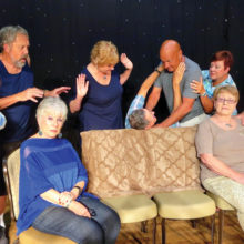 The Turpin brothers struggle over the cost of their father's funeral, while the rest of the family is preoccupied with their own concerns. Front row: Phyllis Novy, Sandy Pallett, Andrea Hummel and John Crawford. Back row: Chris Mank, Merrie Crawford, Jim Janowski, Rick Whitney and Ginger Henry.