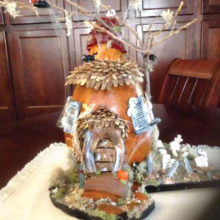 Gourd haunted house created by member Kathy Baylor. Very creative and great use of all materials!