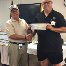 Jay accepts a check from Knights of Columbus' Ken Stosel