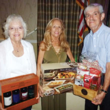 The door prize winners from left to right are Linda Boyd, Roberta Ferrazza and Dennis Evans.