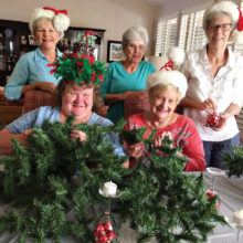 DW members Gwen Fleming, Kay King, Susan Anderson and seated Diane Gramze and LaVerne Walters are working on table decorations for the December 3 P.E.O. Luncheon at Palo Verde Country Club dining room.