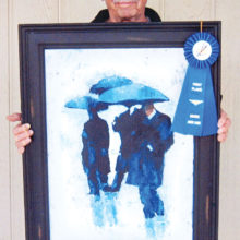 Bob Kwait with his award-winning painting, Rain