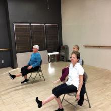 Yoga with the support of a chair