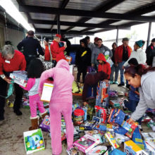 The East Valley Marines donate their time to distribute toys on Christmas Eve as part of the Toys for Tots program.