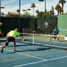 EVIL (East Valley Interclub League) pickleball players (yellow shirts) battle against their opponents