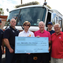 The crew of SLFD's Engine 232 accepts a donation check from the Palo Verde Men's Golf Association President Neil Curtis and the Co-Chair of the major events committee Gary Zahnow.