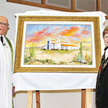 Rev. Marvin D. Arnpriester (left) displays new painting created by artist and church member Judy Yaryan (right) for Sun Lakes UMC fs 30th anniversary.