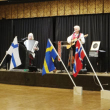 Celebrating our Scandinavian heritage with the five countries' flags and national anthems on March 17 are Sylvia Jorgensen and Carl Nyberg.