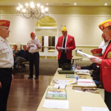 Dave Lott is sworn in as Commandant of the East Valley Marines by Pat Connell from the