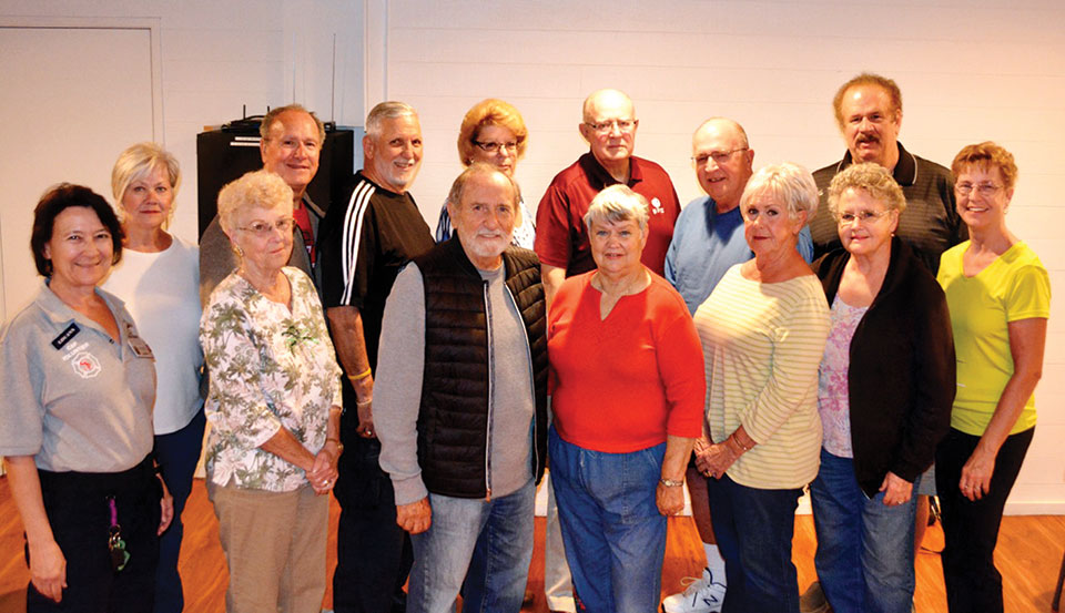 Executive Board members (far left) LouAnn Sedgwick and Pat Weitzel made presentations to volunteers who man the crisis response unit of the SLFD. (photo by Brian Curry)