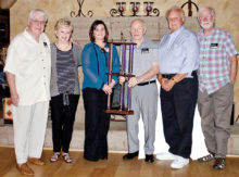 Trophy presentation to On Strike team. Pictured, left to right, are Ralph Harper, Claudia Rapaelian, Tenna Toppola, Bob Reeves, John Greenwood and Andy Boutcher.