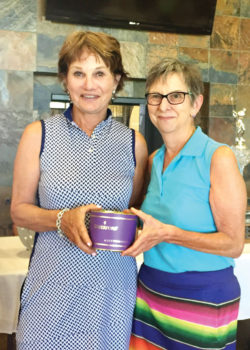 Mary Dyrseth is the 2nd flight winner pictured with club President Betty Schechter