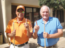 Jerry Cisneros (left) and Jack Hill are the Lucky Shot Pool Club champions.
