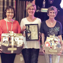 March door prize winners are (left to right) Mary Yasuda, Jackie Morgan and Jan Wilkinson receiving the gift on behalf of Laurie Starr.