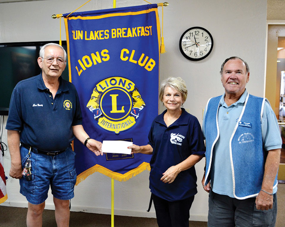 Mac Davey presents a check to Glenn and Janet Cincera from the Sun Lakes Anglers.