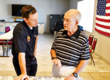 Arizona Fire & Medical Authority Deputy Chief Rob Helie shares memories with Mike Sellers.
