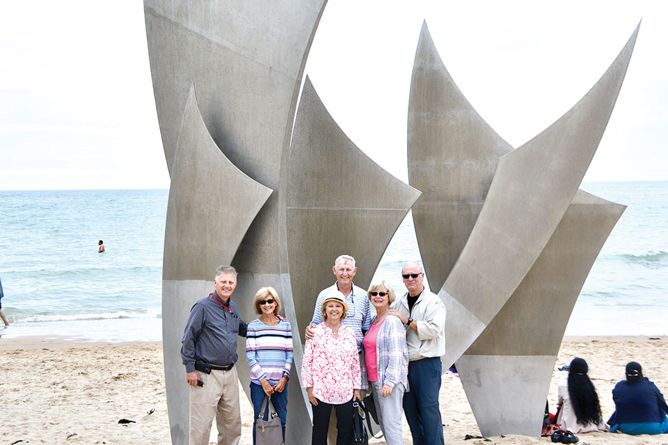 Dale and Dianne Probst, Jim and Peggy Hall and Vic and Joanna Hermann at Omaha Beach, France, in July