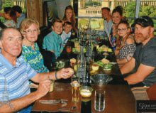 Bob and Arlene Duhon with family in June having lunch at Eiffel Tower