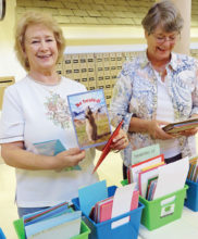 Diana McColly finds just the right card while Doris Brown looks at some of the beautiful cards available for sale.