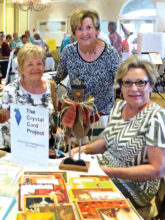 Diana Berry, Charlene Petragallo and Kathy Skrei display fall cards.