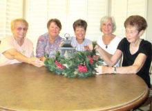 EN members Carol Barnes, Jackie Hutchins, Barbara Mattes, Bonnie Savard and Marcy Petrek finalizing table decorations.