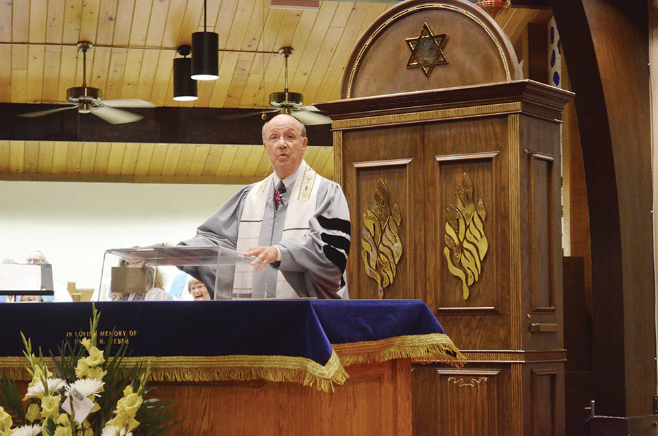 Rabbi Irwin Wiener leading services