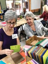 Volunteers enjoy making Crystal Cards.