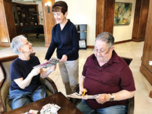 Aaron Dolin, one of the founders of JWV Post 619, is assisted by his wife Joy in handling The Clipper Club, a project which services veterans around the world. Judy Plafker, wife of another founder, Irwin Plafker, is bringing coupons to the committee chairs.