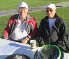 Jerry Vance and Les Schick enjoy the food after their match.