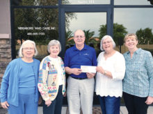 Presenting the check to Eric Ehst, Director of Neighbors Who Care, are Lee Goodheer, Betty Raveret, Sue Bennett and Pat Naive.