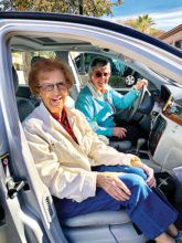Volunteer Dot McNulty and client Betty Frank enjoy each other's company as they run errands.