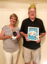 Pictured are Crowned King Neil Donohoe and Dog House Loser Jackie Morgan for the August 6 euchre party.