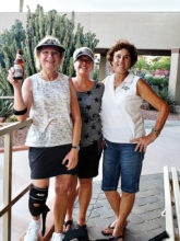 Judy Grefsheim, Kathy Malitar, and Nede Mead like the tennis food, and especially the beverages.