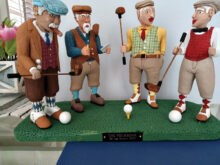 """One of our most talented carvers, Lou Martin, finished this awesome work entitled """"The Foursome,"""" and you can just imagine the work that went into it. The expressions, the details, the attire, and colors are just great. What imagination and talent!"""