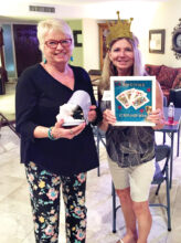 Crowned Euchre King (Vickie Bybee) and Dog House Loser (Sharon Lawrence) from the Oct.