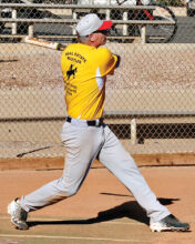 Tom Kasunic shows his homerun swing. (Courtesy of Core Photography)