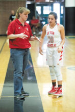 Coach Karen self instructs Megan Giacobbi (Class of 2019) during a game.