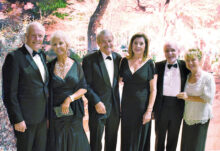 Pictured from left to right are Robert Butt, Joanne Butt, Dick Lathrop, Nancy Lathrop, Emmett Babler, and Carmela Hopkins-Babler entering the Sun Lakes Cottonwood San Tan Ballroom for the Dancing Leaves of Autumn Gala that was held on Nov. 9, 2019. This was the first dance of the 2019/2020 season. This photo was taken at the champagne reception preceding the dance. The reception provided an opportunity to interact with guests, to take photos, and to enjoy the hors d'oeuvres, champagne, and the live instrumental music. The ballroom was beautifully decorated in a fall theme. As the evening progressed, the dinner was scrumptious and the service prompt and courteous. The music was fabulous, performed by Route 66 with vocals from Kathy Bradford. The dancing went on for hours. Everyone had a great time!