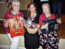 Door prize winners (left to right) are Margaret Oelap, Tanya Desi, and Mary Mullen.