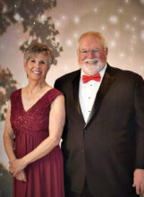 """Pictured are Rob and Shirl Spade entering the ballroom for last February's """"We'll Only Have Paris"""" formal dance. Rob and Shirl have been presidents of the Cotillion Dance Club for the last five seasons. We appreciate their hard work, dedication, and leadership. We are looking forward to the remaining dances this season."""