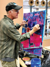 Member Howard Lundgren working on an acrylic painting