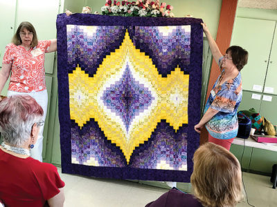 Shar Schmutz explains decisions for long-arm quilting.
