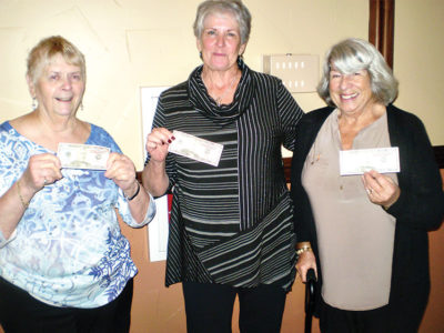 These ladies were the $50 winners in the raffle drawings held at the December Holiday lunch. Standing (left to right) are Peg Clapp, Terry Dobbs, and Lucy Geller.